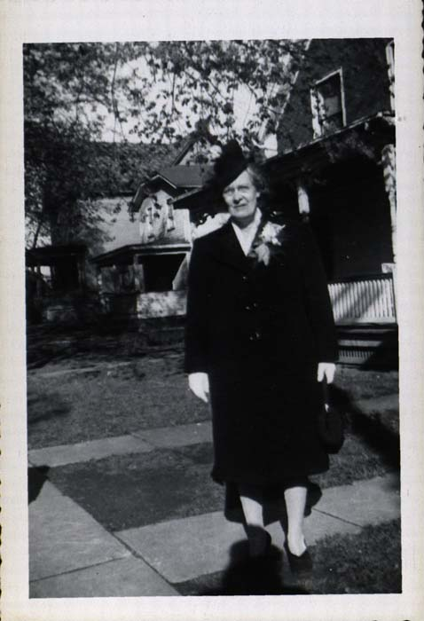 Photograph, woman in long coat and hat