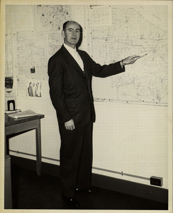 Photograph, Robert Abbott with map